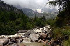 Mountain stream in the Alps Stock Photos