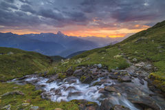 A mountain stream on a background of a sunset Royalty Free Stock Image