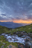 A mountain stream on a background of a sunset Royalty Free Stock Photography