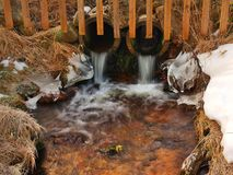 Mountain stream at beginning of winter time, old orange dry grass. Mountain stream at beginning of winter time, old orange dry grass on both banks, ice on Royalty Free Stock Photography
