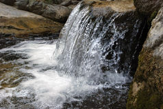 Mountain stream with a cascade in the mountains of Tien Shan Royalty Free Stock Photography