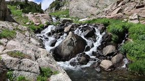 Mountain Stream Cascading Through Boulders stock video footage