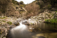 Mountain stream cascading into a natural pool in Corsica Royalty Free Stock Photography