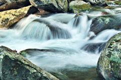 Mountain Stream Cascading over Rocks Stock Photo