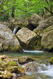 Mountain stream with cascading waterfalls Stock Photo