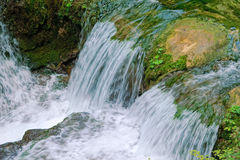 Mountain stream Stock Images