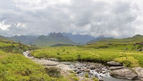 Mountain stream, mountain and clouds. Drakensberg South Africa Royalty Free Stock Image
