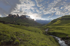 Mountain stream and clouds Stock Image