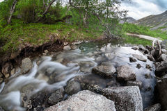 Mountain stream coming down from tops of the mountains in Khibins, long exposure, wide angle Stock Photo