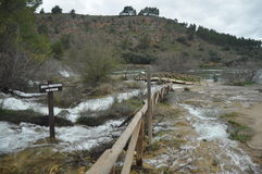 Mountain stream, flood. Flooded path. Closed trail. Ruidera National Park. Royalty Free Stock Photography