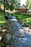 Mountain stream flowing. Stock Image
