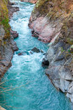 Mountain stream flowing through the red rocks Royalty Free Stock Photo