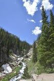 A mountain stream flows through a mountain gorge. Stock Image