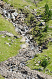 Mountain stream. Flows through the rocks in Alps stock photos