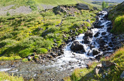 Mountain stream. Flows through the rocks in Alps Royalty Free Stock Images