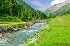 Mountain stream and high peaks of Austrian Alps Royalty Free Stock Image