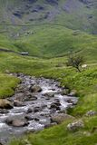 Mountain stream, hut, drystone walls, Haweswater, Cumbria, UK stock photos