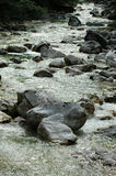Mountain stream with large rocks Royalty Free Stock Photo