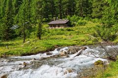 Mountain stream with malga Stock Images
