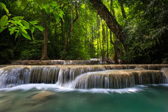 Mountain stream among the mossy stones. Erawan waterfall, Thailand Stock Images