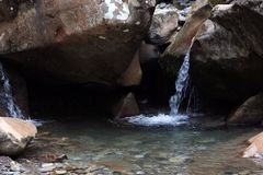 Mountain stream.the water flows from the rocks. Mountain stream.pure mountain water flowing over rocks Stock Images