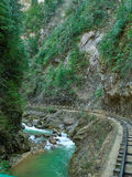 Mountain Stream and railroad in Springtime. Royalty Free Stock Images
