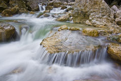 Mountain stream and rapids. Mountain stream with water flowing over rocks Royalty Free Stock Photo