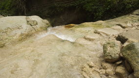 Mountain stream river. Mountain river. Stones and mountain river with small waterfall. Flowing mountain stream with transparent water and stones. Rocky Stream stock footage
