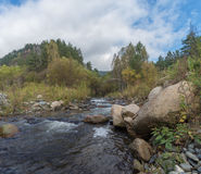 Mountain stream in Sayan Stock Photography