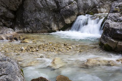 Mountain stream with small waterfall Royalty Free Stock Photos