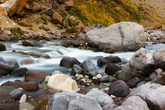 Mountain stream stones. Mountain stream by an autumn surrounded by stones and rocks Stock Photo
