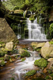 Mountain stream waterfall. Tranquil scene of a waterfall on a mountain stream royalty free stock images
