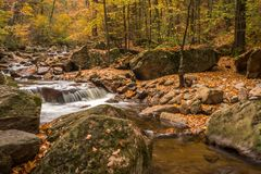 Mountain stream with waterfall in an autumn forest Royalty Free Stock Photos