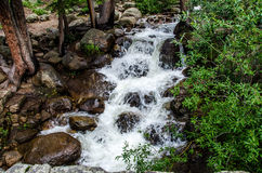 Mountain stream waterfall Stock Images