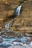 Mountain stream waterfall. Mountain stream and waterfall surrounded by stones and rocks Stock Image