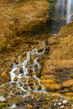 Mountain stream waterfall. Mountain stream and waterfall surrounded by stones and rocks Stock Photography