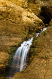 Mountain stream waterfall. Mountain stream and waterfall surrounded by stones and rocks Royalty Free Stock Photography