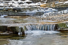 Mountain stream in the winter. Royalty Free Stock Photo