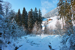 Mountain stream winter landscape. A mountain stream under a thick blanket of snow in the richly snow covered landscape of the Allgäu Alps (Bavaria, Germany Royalty Free Stock Photography