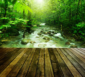 Mountain stream. Wooden platform and tropical mountain stream with sunbeam in a morning Stock Images