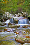 The mountain streams. The stream is flowing quietly in the valley Stock Image
