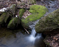Mountain streams. Small streams around covered with moss royalty free stock photography