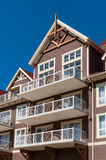 Mountain style apartment building Stock Photography
