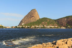 Mountain Sugarloaf from Park Flamengo with stones and waves in G Royalty Free Stock Images