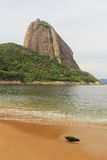 Mountain Sugarloaf Red beach (Praia Vermelha) empty sea sand in Stock Photos