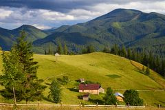 Mountain summer landscape with wooded green hills. Beautiful sunny scenery in clear weather.  royalty free stock photo