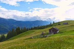 Mountain summer landscape with wooded green hills. Beautiful sunny scenery in clear weather.  royalty free stock photography