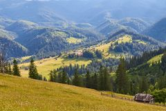 Mountain summer landscape with wooded green hills. Beautiful sunny scenery in clear weather.  royalty free stock image