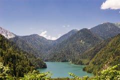 Mountain summer panoramic view with lake Ritsa. Royalty Free Stock Images