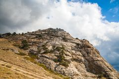 Mountains and clouds. Mountain in a summer sunny day and clouds Stock Image